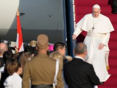 Pope Francis walks down the steps on an airplane as he arrives at Budapest international airport (Gregorio Borgia/AP)
