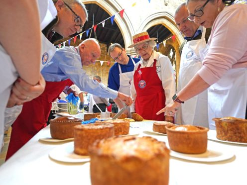 Judging is under way at the Annual British Pie Awards at St Mary's Church in Melton Mowbray, Leicestershire (Jacob King/PA)