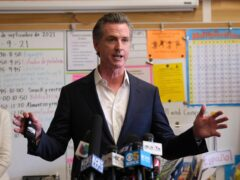 California will remove the word 'alien' from its state laws after Governor Gavin Newsom called it 'an offensive term for a human being' that has 'fueled a divisive and hurtful narrative' (Nick Otto/AP)