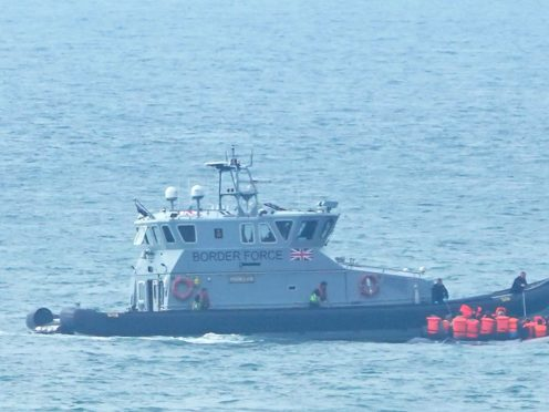 A Border Force vessel intercepts a group of people thought to be migrants in a small boat off the coast of Kent (Gareth Fuller/PA)