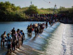 Haiti migrants waiting in Del Rio and Ciudad Acuna to get access to the United States, cross the Rio Grande (Marie D De Jesus/AP)