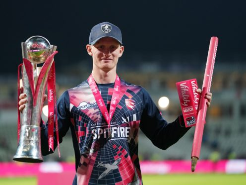 Jordan Cox celebrates with the trophy and the player of the match award (Mike Egerton/PA)