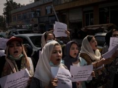 Women march to demand their rights under Taliban rule during a demonstration near the former Women's Affairs Ministry building in Kabul, Afghanistan (AP)