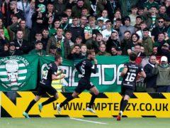 Livingston's Andrew Shinnie, centre, celebrates his winner against Celtic (Andrew Milligan/PA)