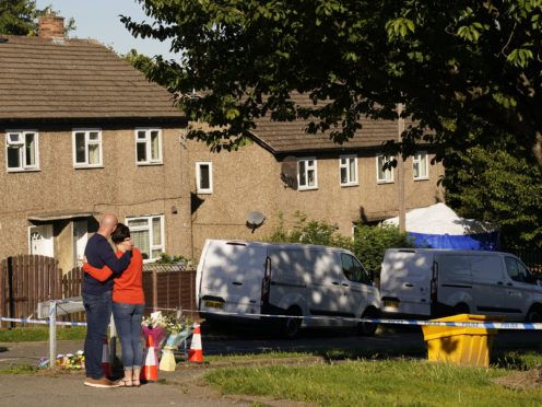 The father to some of the victims leaves flowers at the scene in Chandos Crescent, Killamarsh, near Sheffield, where four people were found dead at a house on Sunday (Danny Lawson/PA)