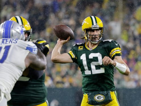 Aaron Rodgers bounced back from a torrid first game of the season to throw four touchdowns in a 35-17 win for the Green Bay Packers over the Detroit Lions (Mike Roemer/AP)