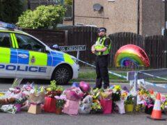 Flowers near to the scene of the murders in Chandos Crescent, Killamarsh, near Sheffield (PA)