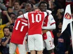 Arsenal scored twice late on (Tim Goode/PA)