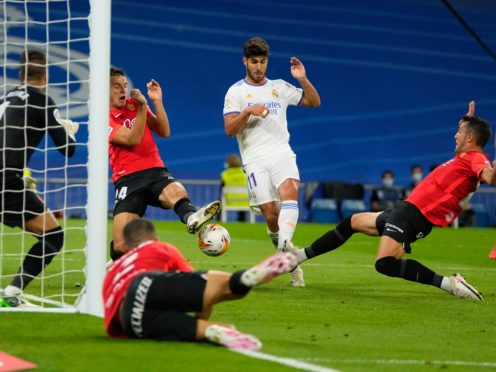 Marco Asensio scored a hat-trick for Real Madrid in their 6-1 win over Mallorca (Manu Fernandez/AP/PA)