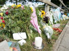 Floral tributes at Cator Park in Kidbrooke, south London (PA)