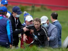 Actor Tom Felton is helped after collapsing on the 18th hole during a practice day at the Ryder Cup at the Whistling Straits Golf Course (Ashley Landis/AP)