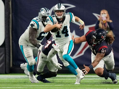 Carolina Panthers quarterback Sam Darnold breaks away from Houston Texans defensive tackle Roy Lopez (Eric Christian Smith/AP)