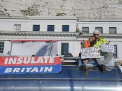 Protesters from Insulate Britain sit on top of a vehicle as they block the A20 in Kent, which provides access to the Port of Dover in Kent (Gareth Fuller/PA)