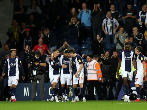 Karlan Grant, centre, and West Brom celebrate their late winner (Bradley Collyer/PA)