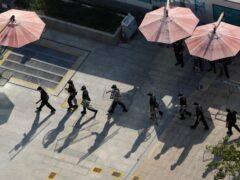 Security guards in China (File/Ng Han Guan/AP)