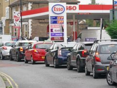 Motorists queue for petrol at an Esso petrol station in Brockley, south London (PA)