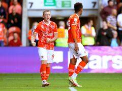 Shayne Lavery, left, celebrates after scoring Blackpool's winner (Tim Markland/PA)