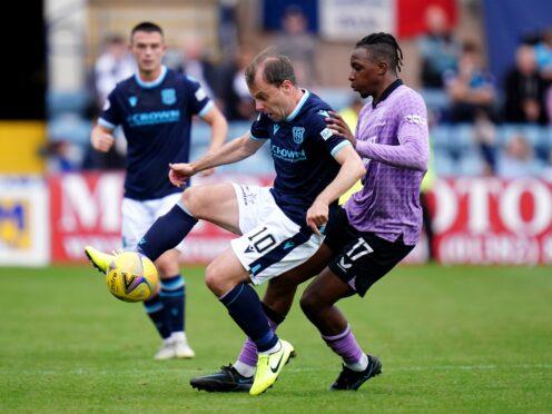 Dundee's Paul McGowan, left, tussles with Rangers goalscorer Joe Aribo at Dens Park. (Jane Barlow/PA)