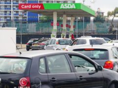 Cars queue for fuel at an Asda petrol station in south London amid continued panic buying (Dominic Lipinski/PA)