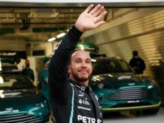 Lewis Hamilton celebrates his 100th career win (Yuri Kochetkov/AP)