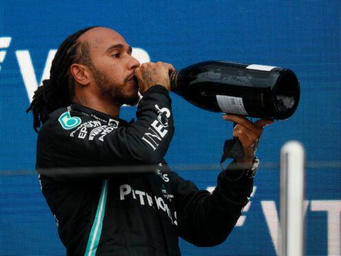 Lewis Hamilton toasts his 100th grand prix win (Yuri Kochetkov/AP)
