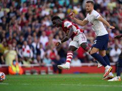 Arsenal's Bukayo Saka scores his side's third goal (Nick Potts/PA)