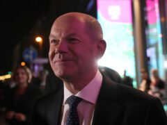Olaf Scholz, finance minister and SPD candidate for Chancellor, leaves after attending a TV broadcast on the parliamentary elections in Berlin (Michael Probst/AP)