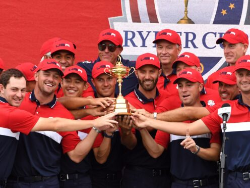 Team USA team celebrate with the Ryder Cup trophy after thrashing Europe 19-9 at Whistling Straits (Anthony Behar/PA)