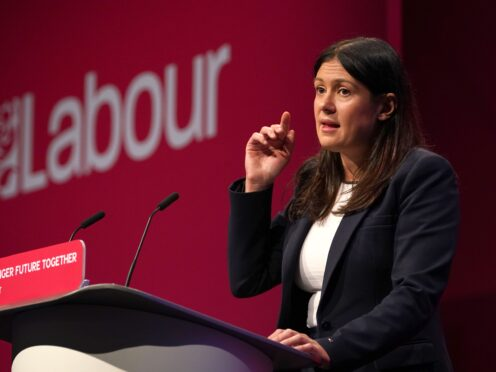 Lisa Nandy speaks on stage at the Labour Party conference (Gareth Fuller/PA)