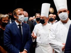 French president Emmanuel Macron, left, at the food fair (Ludovic Marin, Pool Photo via AP)