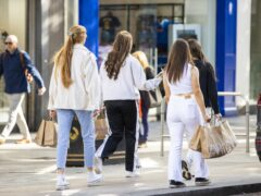 Shoppers on the high street in Belfast (PA)