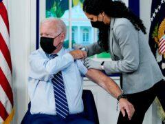 President Joe Biden receives a booster shot (Evan Vucci/AP)