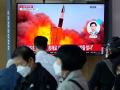 People watch a TV showing a file image of North Korea's missile launch during a news program at the Seoul Railway Station on Tuesday (Ahn Young-joon/AP)
