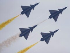 Members of the August 1 Aerobatic Team of the Chinese People's Liberation Army Air Force perform during the 13th China International Aviation and Aerospace Exhibition (AP)