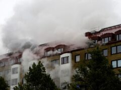 Smoke billows from an apartment building after an explosion in Annedal, central Gothenburg (TT via AP)