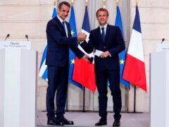 Greek prime minister Kyriakos Mitsotakis and French president Emmanuel Macron (AP)