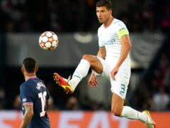 Ruben Dias enjoyed testing himself against Lionel Messi, despite Manchester City's 2-0 defeat against Paris Saint Germain (Julien Poupart/PA Images).