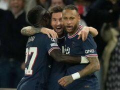 Lionel Messi, centre, celebrates his goal with fellow scorer Idrissa Gana Gueye, left, and Neymar (Christophe Ena/AP)