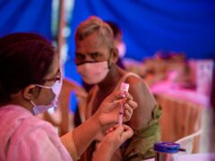 A health worker prepares to administer a dose of Covaxin during a vaccination drive against Covid-19 in New Delhi (Altaf Qadri/AP)