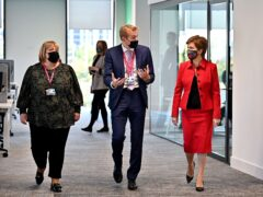 First Minister Nicola Sturgeon meets staff at the new offices of Social Security Scotland in Dundee (Jeff J Mitchell/PA)