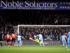 Luton's Elijah Adebayo scores the opening goal (David Davies/PA)