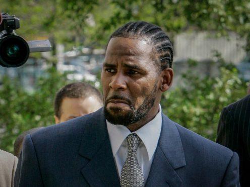 R Kelly denies the charges (Charles Rex Arbogast/AP/PA)