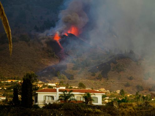 Lava flows from an eruption of a volcano at the island of La Palma (Jonathan Rodriguez/AP)