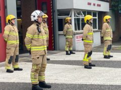 Firefighters at Knock Station in east Belfast stand for a minute silence in memory of those who lost their lives in the 9/11 terror attacks. (Rebecca Black/PA)