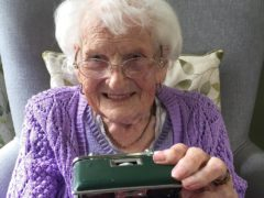 A care home resident holding a memory box (Wessex Heritage Trust/PA)