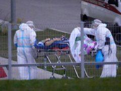 Medical staff tend a coronavirus patient at Kommunarka, outside Moscow (Alexander Zemlianichenko/AP)