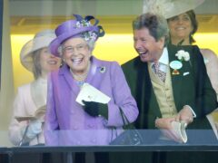 The Queen with her racing manager John Warren after her horse, Estimate, won the Gold Cup in 2013 (Tim Ireland/PA)