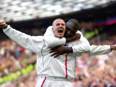 David Beckham celebrates his free-kick against Greece (Phil Noble/PA)