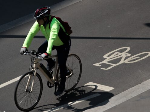 A cyclist (Aaron Chown/PA)