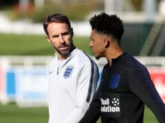 England manager Gareth Southgate (left) is backing Jadon Sancho to impress, if given time (Martin Rickett/PA)